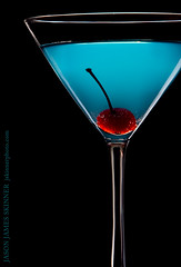 Blue Martini (skinr) Tags: cherry stem drink beverage bubbles martiniglass lowkey studiolighting glassware stemware onblack bluemartini onelight foodphotography alkaseltzer lightscienceandmagic wwwjskinnerphotocom jasonjamesskinner