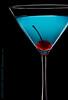 Blue Martini (skinr) Tags: cherry stem drink beverage bubbles martiniglass lowkey studiolighting glassware stemware onblack bluemartini onelight foodphotography alkaseltzer lightscienceandmagic wwwjskinnerphotocom jasonjamesskinner