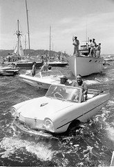 Start of the Sydney-Hobart Yacht Race, 1971 (State Library of New South Wales collection) Tags: people blackandwhite bw water car race benz boat 1971 mare zoom harbour steel sydney sailors surreal wave australia bn persone nave newsouthwales regatta 1960s mast yachts splash innovation 1970s seafront submerged trafficjam bianconero sydneyharbour amphicar amphibious westgermany yachtrace sydneyhobart sydneytohobartyachtrace carboat statelibraryofnewsouthwales commons:event=commonground2009