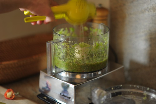 Adding lime juice to salsa verde by Cookthink