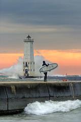 Surf's Up in Frankfort, Michigan! (ShaneWyatt) Tags: sunset lighthouse beach pier michigan surfer surfing lakemichigan explore blueribbonwinner 5photosaday frankfortmi hdraddicted shanewyatt