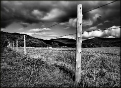 (Gayle_T) Tags: autumn sky bw mountains fall field clouds fence landscape vermont post ominous sunny blackdiamond artlegacy bwartaward