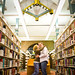 a kiss in College of St. Benedict's library | engagement photo near St. Cloud Minnesota