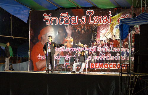 Speakers try to warm up the crowds on a very cold Chiang Mai evening