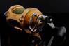 Tica fishing reel (Chook with the looks) Tags: nikon lightbox manfrotto d300 tabletopphotography photofaceoffwinner photofaceoffplatinum pfogold pfoplatinum