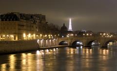 Seine River and Eiffel Tower at Night (BostonCityWalk) Tags: road city bridge winter paris france water fog seine night clouds buildings river island lights eiffeltower arches litup lightstream
