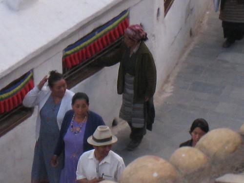 A Tibetan woman spinning prayer wheels