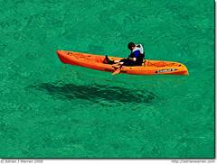 So... (AdrianWarren) Tags: uk blue sea england green water coast boat cornwall kayak turquoise floating f45 gb rowing polarizer 2008 opticalillusion porthcurno cerulean polariser 1350s oceankayak canonef300mmf4lisusm canoneos400ddigital cognitiveillusion scramblerii