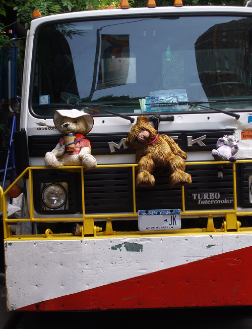 stuffed animals on the grill of a New York City truck, Manhattan, NYC