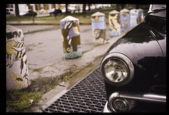 Library Square (patrickjoust) Tags: auto city urban usa color film car rain analog america 35mm canon square lens ed prime us nikon focus automobile flickr day kodak library painted united patrick maryland slide baltimore v chrome rainy patterson 40 states manual 40mm posts expired joust 35 ektachrome coolscan e6 canonet ql17 giii estados reversal unidos f17 autaut lovelycity patrickjoust
