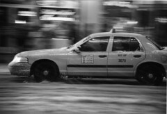New York - Running in the snow (manlio_k) Tags: bw snow newyork car taxi panning manlio castagna manliocastagna manliok