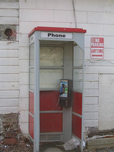 Old red and metal phone booth