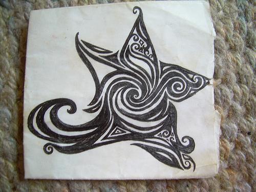Symbol star tattoo