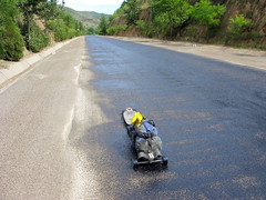 Wet tar on the road near Chingning, Gansu Province, China