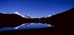 Crack of dawn at Chandertal lake, Spiti (sapru) Tags: blue sky mountain lake reflection sunrise trek reflections landscape still cool fantastic quiet peace horizon lakes relaxing restful calming surreal floating peaceful tranquility calm silence harmony serenity serene dreamlike hush reflexions stillness tranquil himachal himalayas balanced poised spiti gentle daybreak soothing calmness treks quietness comforting himachalpradesh composed otherworldly illusory unruffled chandertal untroubled unperturbed lahaul flickrific chandrataal abigfave lahual unworried firstrays trancelike unlimitedphotos worldtrekker lahaulandspiti chandertallake lakesinlahaulandspiti lakesinhimachal treksinhimachal dblringexcellence tplringexcellence