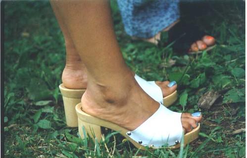 Ebony feet in flip flops