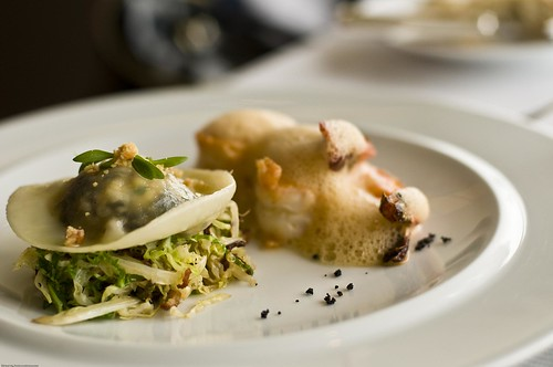 Wild Mushroom Ravioli With King Prawn On A Bed Of Sauteed Chinese Cabbage With Bacon