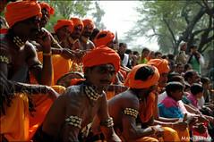 Turbanators (~FreeBirD~) Tags: portrait orange india male colors face look necklace colorful masculine traditional crowd views strong indians mb 2007 turbans freebird haryana peoplem incredibleindia manibabbar maniya crowdportrait