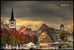 Strasbourg in Cartoons  (Mike G. K.) Tags: city bridge autumn trees windows france tower cars church smile leaves architecture buildings river boats cityscape view distorted cartoon warp roofs strasbourg alsace saturation hdr distort skew cartoonish skewed warping photomatix 3exp
