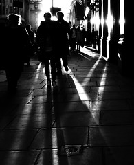 The long day closes (Ian Brumpton) Tags: street city uk greatbritain sunset shadow england people urban blackandwhite bw black london blancoynegro silhouette blackwhite calle strada sundown unitedkingdom britain pavement candid citylife streetshots streetphotography silhouettes highcontrast streetportrait streetlife rangefinder piccadillycircus explore sidewalk shadowplay rue westend contrejour blackdiamond sunspots streetphotographer streetcandid explored platinumheartaward artlegacy lumixaward bwartaward scattidistrada