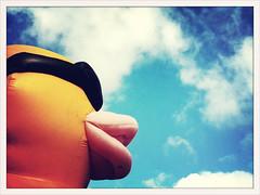 street blue sky urban sun sunglasses yellow clouds analog duck birmingham cross cloudy framed crossprocess alabama streetphotography inflatable frame processed quack rayban 3gs iphone iphoneography jasonlparks