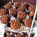 rose cupcakes                                        w chocolate leaves