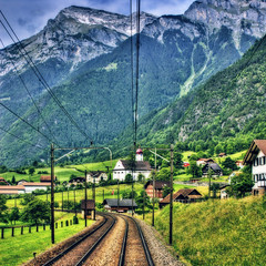 Switzerland. (@yakobusan Jakob Montrasio ) Tags: switzerland europe alps mountain mountains loaded train nikond50 hdr hdri photoshop edited photomatix singleraw houses nature grass day bright beautiful tourism safe snow stone weed powerlines railroad orton visiongroup vision100