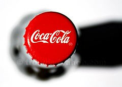 Bottle Cap with Shadow (trondjs) Tags: shadow red white black norway canon logo corporate design bottle colours cola drink coke lemonade cap handheld cocacola dslr 2008 thirst coca bottlecap minimalistic logos minimalist artyfarty thirsty softdrink brus simplistic stylistic 400d trondjs canonefs1855mm13556ii norwegianbottle