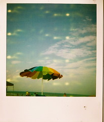 (vinnie bailey) Tags: ocean sky beach clouds umbrella myrtlebeach rainbow southcarolina