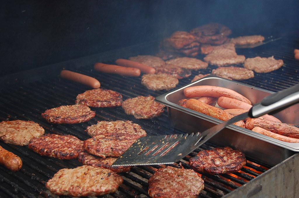 """""""That outdoor grilling is a manly pursuit has long been beyond question. If this wasn't firmly understood, you'd never get grown men to put on those aprons with pictures of dancing wienies and things"""