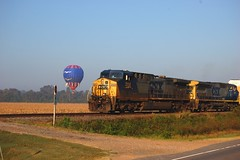 SkyBird Meets CSX (Explore) (Paul L. Nettles) Tags: railroad blue bird train fly flying diesel blu seagull gull aircraft hotair balloon flight engine rail loco trains explore envelope rails hotairballoon locomotive railfan ironhorse jonathanlivingstonseagull csx dieselengine trainspotter lighterthanair hotairballooning railroading foamer csxt railspotter railhead skybird primemover darkfuture steelrails steelrail trainfan 1on1planestrainsautosphotooftheweek trainfanning wwwbayouballoonadventurescom csx204 csx7911 darkfuturepaint 1on1planestrainsautosphotooftheweeknovember2008