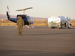 Helicopter Pilot (Rennett Stowe) Tags: tarmac helicopter pilot jumpsuit rotor refueling greenuniform refuelingtruck rotorblade helicopterpilot gettingreadytofly goingtofly californiaairnationalguard smallhelicopter walkingtoanaircraft walkingonthetarmac refuelingahelicopter stripedhelicopter chevronrefuelingtruck helicopterrotorblade