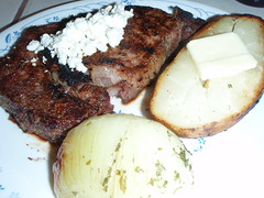 3038108185 98abcb62a6 m Grecian Rib Eye Steak with Baked Onion and Potato.