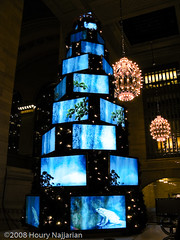 Xmas tree with TVs (Houry Photography -on/off) Tags: blue eye colors lights evening holidays frog chandeliers rushhour grandcentralterminal catchers flatpaneltv amazingshots