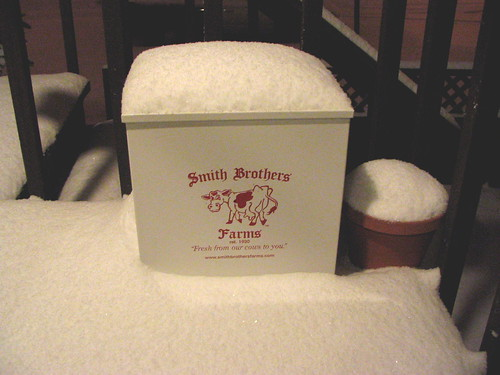 Snow from this morning, piled on a milk box.
