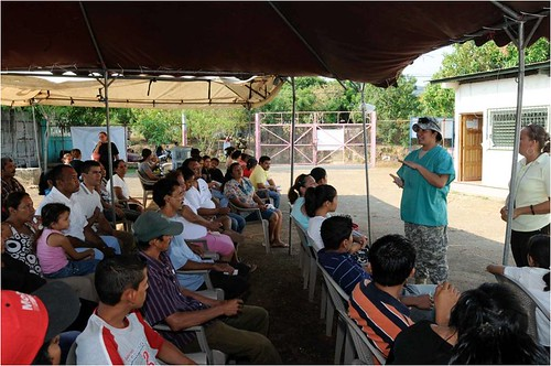 Staff Sgt. Aleya Robleto from Rodeo, Calif. explains the dental clinic process to a crowd of waiting Nicaraguans