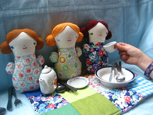 Sleepover dolls having a tea party