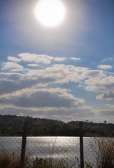 Summer sun, in the autumn (Claudia Oseki) Tags: road brazil sky lake nature brasília brasil landscape cloudy paisagem estrada goiânia goiás cloudys