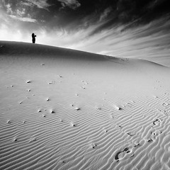 His Steps (Ageel) Tags: trip travel sunset sky bw cloud white man black art hail clouds d50 square lens landscape photography model nikon desert squares fineart sigma kingdom wideangle arabic arab saudi sa arabian 1020mm sq saudiarabia bnw squared ksa sigma1020mm       ageel    bwsquare