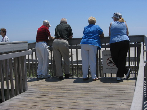 A Group of Middle Aged People Looking out over the Beach and Ocean in front of the Hilton Casino