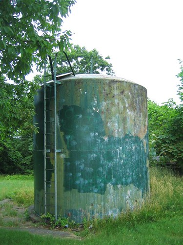 Smaller water tower tank at the top of the hill