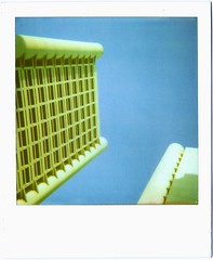 Touch the sky (feat. Kenzo Tange) (deFe.) Tags: blue light shadow sky building tower buildings polaroid day blu ombra edificio towers toycamera cielo 600 bologna luce fiera kenzotange touchthesky po