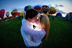 love is what makes the world go round . . . (Niko Miguel) Tags: newmexico love balloons engagement nikon kiss hotairballoon niko nikondigital gpg fps fpc nikond200 albuquerquenewmexico top20nm strobist nikonstunninggallery nikogvillegas nikkor105mmf28fisheye
