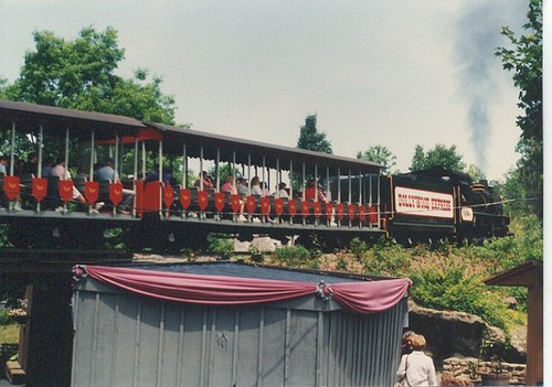 The Dollywood Express passing over a bridge. Dollywood Amusement Park. Pidgeon Forge Tennesee. May 1990. by Eddie from Chicago