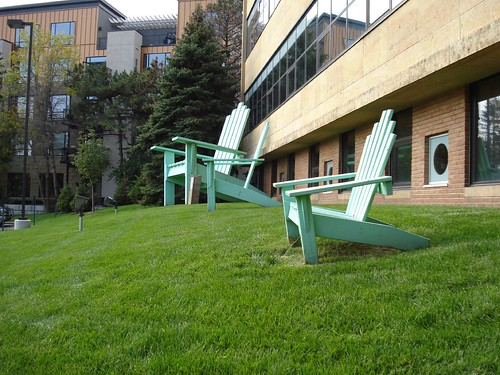 Green Adirondack Chairs of Varying Size