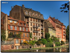 Quai des bateliers, Strasbourg (Mike G. K.) Tags: houses people france buildings river path ducks strasbourg ill swans alsace colored polarizer hdr blueribbonwinner photomatix 3exp mywinners colorphotoaward elitephotography quaidesbateliers
