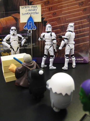 Patrons Line Up at the Death Star Library Information Desk