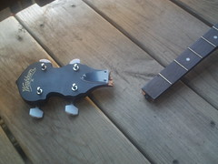 The banjo's peghead had been snapped off.  Someone dropped it, probably.