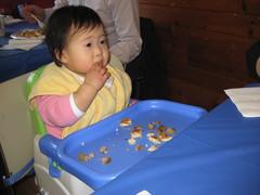 Aki having pancakes and sausage