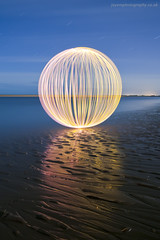 A lonely orb (~ jules ~) Tags: longexposure pink blue light sea orange lightpainting reflection beach yellow clouds ball circle stars globe julian sand nikon paint orb sigma marshall sphere round jules lightpaint lapp d300s jayemphotography
